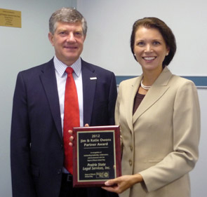 Board Chair, Bill Springer, presents 2012 Partner Award to Denise Conklin of Prairie State Legal Services