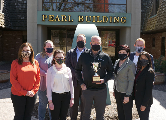 Pearl Companies, 2020 Campaign Achievement Recipient. L-R: From Pearl Companies - Lisa Hoogerwerf, Eileen Ahl, Lisa McSherry, Corey Smith, and Gary Pearl; United Way President, Jennifer Zammuto; and 2020 Campaign Chairs Seth and Sylvia Davis